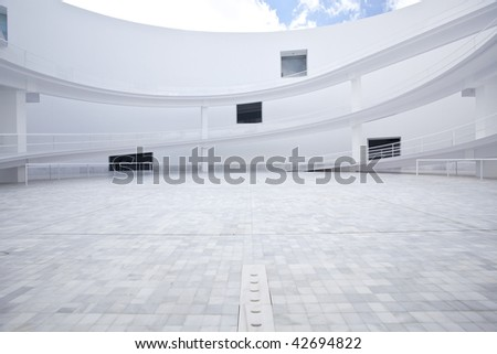 Abstract building exterior under blue sky - stock photo