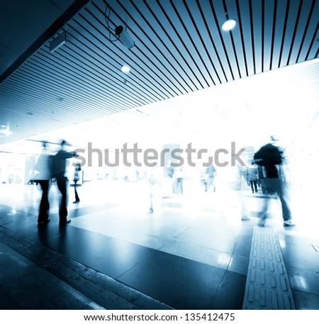 abstract business people rush on urban shopping center blur motion
