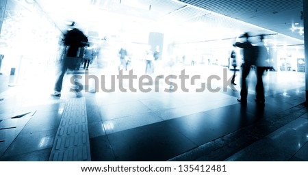 abstract business people rush on urban shopping center blur motion - stock photo