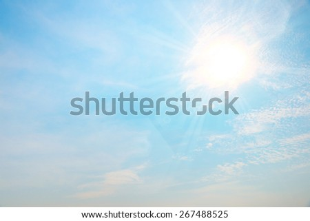 Abstract busy bright cloud over blue sky with bright sunstar flare background - stock photo