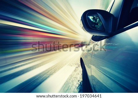 Abstract car driving in city, blurred motion background - stock photo