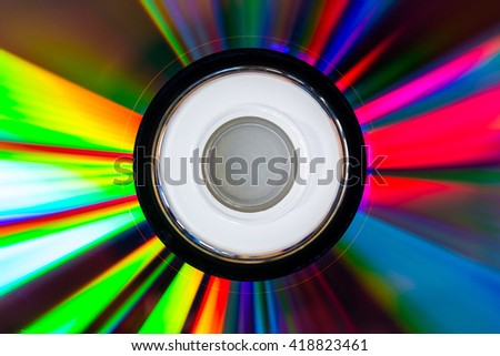 Abstract CD-ROM or DVD-ROM with colorful light. - stock photo