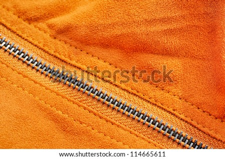 Abstract chamois background with seam and fastener - stock photo