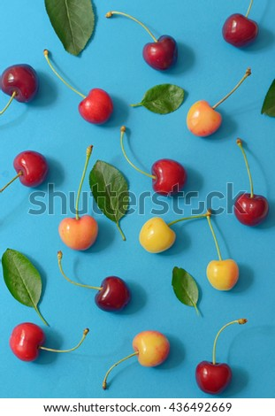 Abstract cherry isolated on blue paper