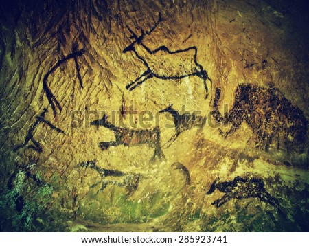 Abstract children art in cave. Black carbon paint of human hunting on sandstone wall, copy of prehistoric picture. - stock photo