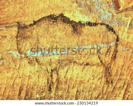Abstract children art in sandstone cave. Black carbon paint of bison on sandstone wall, copy of prehistoric picture.  - stock photo