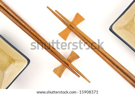 Abstract Chopsticks and Bowls Isolated on a White Background.