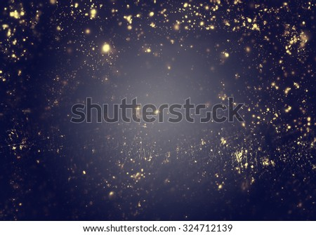 Abstract Christmas  background - golden lights, flash , night city, lens flare.   - stock photo