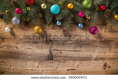 Abstract Christmas background with spruce branches on old wooden table. - stock photo