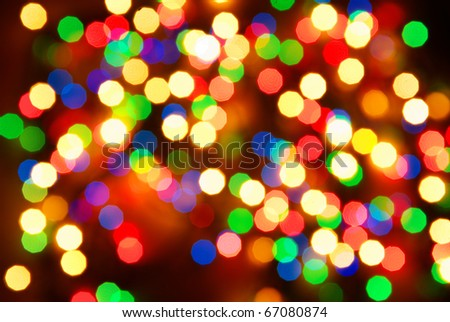Abstract christmas lights as background on black - stock photo