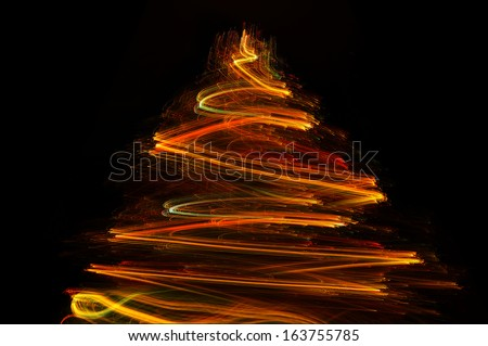 Abstract Christmas tree, paint with light using the multicolored optical fiber - Light painting : long exposure time laps technique in black room  - stock photo