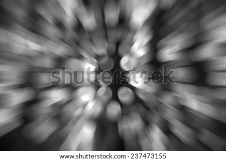 Abstract circular bokeh against dark background with zoom effect for use at graphic design