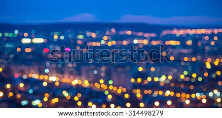 abstract circular bokeh city lights with horizon colorful background, panorama  - stock photo