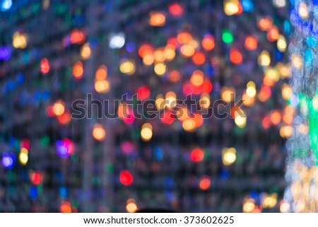 Abstract circular light bokeh New Year Festive background of defocused decorated xmas tree bokeh composition - stock photo