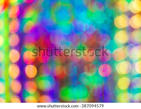 Abstract circular light bokeh New Year Festive background of defocused decorated xmas tree bokeh composition