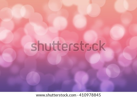 Abstract circular pink and purple light bokeh background - stock photo