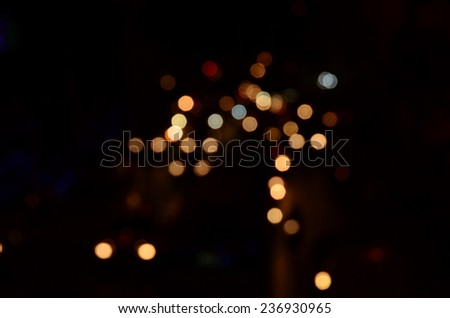 abstract city background lights night blur focus dark yellow colorful