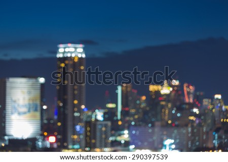 Abstract city, blurred photo bokeh during twilight - stock photo