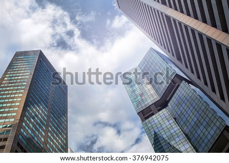 Abstract city construction, skyscrapers on sky background - stock photo