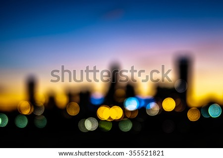 abstract city skyline silhouette at early morning sunrise - stock photo
