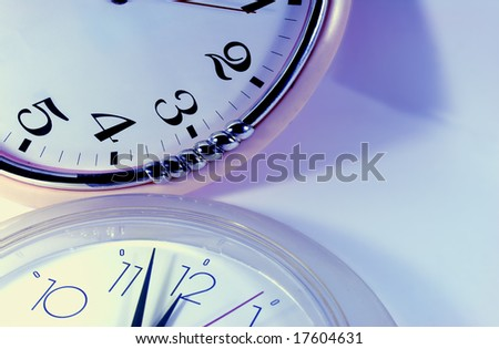 abstract clock in blue light - stock photo
