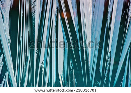 Abstract close up macro of a transparent frozen layer of ice over water.  - stock photo