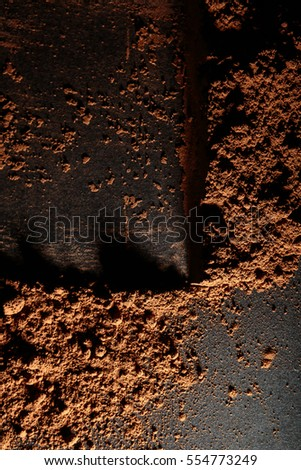 Abstract Close-up of Cacao Powder over Black Background.