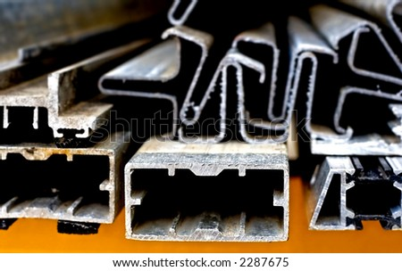 abstract close-up of the cut surface of aluminum bars - stock photo