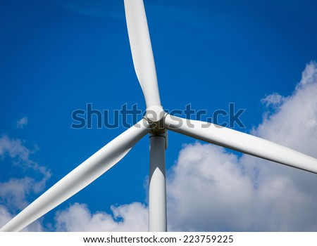 Abstract close up of Wind Turbine producing alternative energy - stock photo