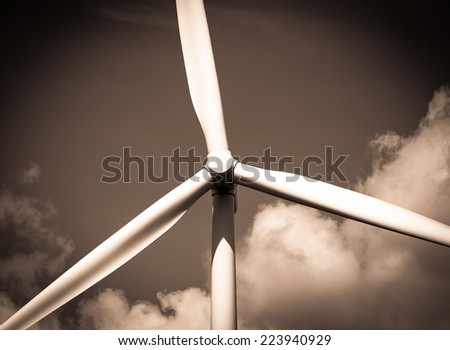 Abstract close up of Wind Turbine producing alternative energy : Sepia Filtered - stock photo