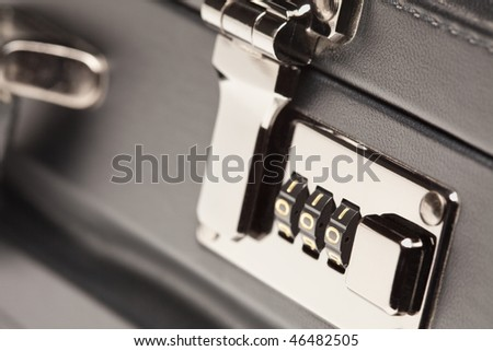 Abstract Close Up Shot of a Black Leather Briefcase Latch and Lock. - stock photo