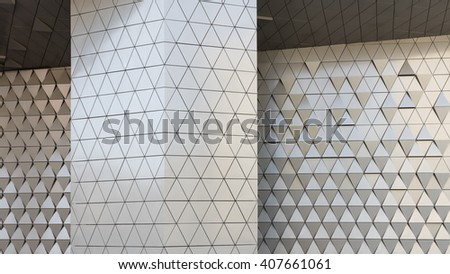 Abstract close-up view of modern aluminum ventilated facade of triangles - stock photo