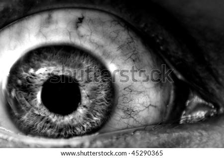 Abstract closeup of a dark eyeball wide open. - stock photo