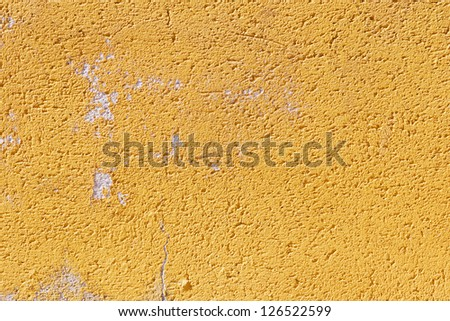 Abstract closeup of a plastered front with orange paint