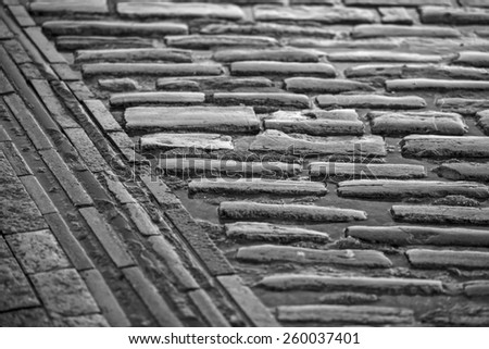 Abstract cobblestone paving with horizontal and vertical converging lines