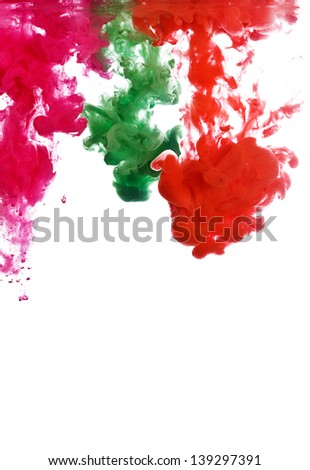 Abstract color paint in water isolated on white background - stock photo