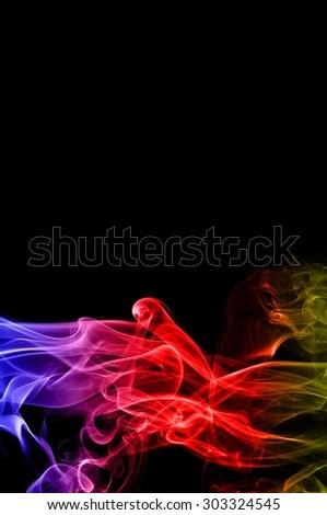Abstract color smoke on black background, smoke background,colorful ink background,blue,red,yellow, beautiful smoke - stock photo