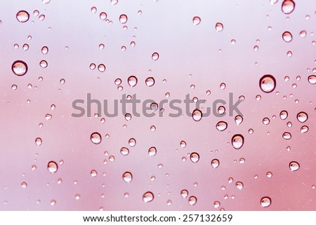 Abstract color tone of Drops on glass after rain - stock photo