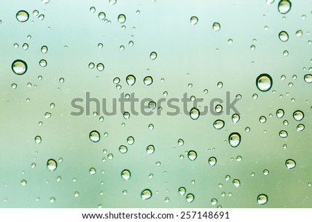 Abstract color tone of Drops on glass after rain