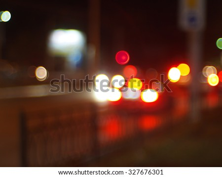 Abstract colored lights of the night city. Blurred image of light from the glare of headlights, traffic lights and windows for use as a background. - stock photo