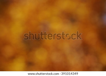 abstract colorful autumn background in bright gold, orange, red and brown colors