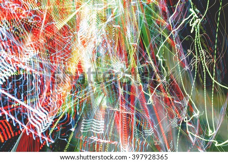 Abstract colorful background. Freezelight effect. Shoot with long exposure. Blurred neon chaotic light bulbs. - stock photo