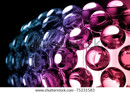 Abstract colorful background with glass spherical design elements of modern chandelier - stock photo