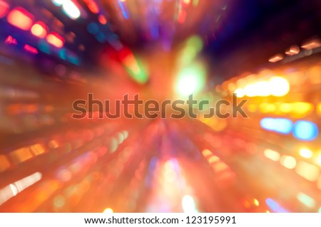 Abstract colorful background with lights in motion - image of defocused lights on the Christmas tree with manual zoom out - stock photo