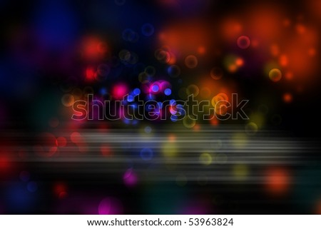 Abstract colorful blurs on dark background.