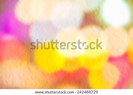 abstract colorful bokeh on mulberry paper background. - stock photo