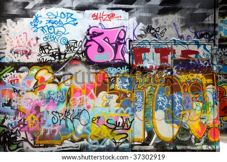 Abstract colorful graffiti background in a wall - stock photo
