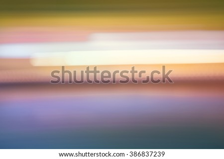 Abstract colorful horizontal streaked city lights background - stock photo