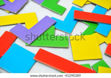 Abstract colorful 80s shapes scattered on a white floor.