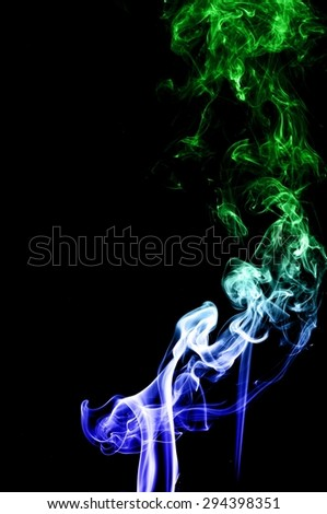 Abstract colorful smoke on black background, smoke background,colorful ink background,Blue and Green smoke, beautiful smoke